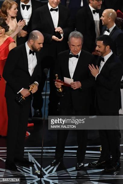 US actor Warren Beatty holds the card reading Best Film 'Moonlight next to La La Land producer Jordan Horowitz and host Jimmy Kimmel after...
