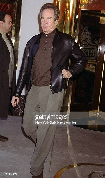 Actor Warren Beatty leaves the Russian Tea Room after lunching with his wife Annette Bening and two of their children
