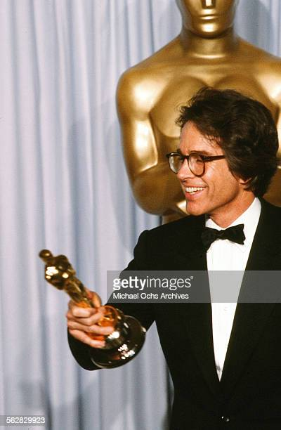 Actor Warren Beatty poses backstage after winning Best Director for REDS during the 54th Academy Awards at Dorothy Chandler Pavilion in Los...