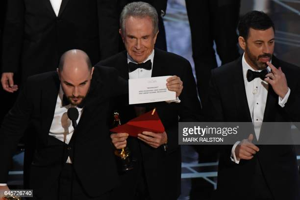 US actor Warren Beatty shows the card reading Best Film 'Moonlight next to La La Land producer Jordan Horowitz and host Jimmy Kimmel after...