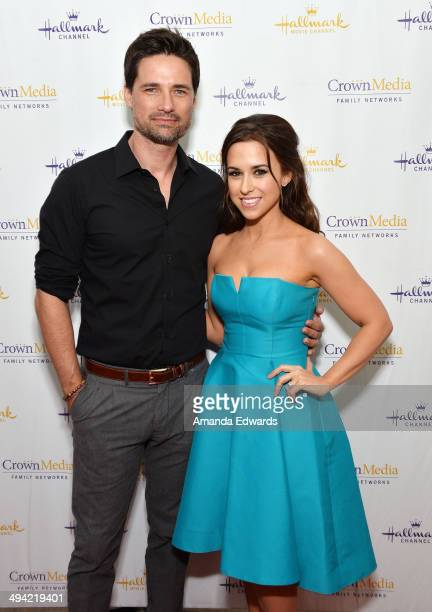 Actor Warren Christie and actress Lacey Chabert arrive at The Color Of Rain premiere screening presented by the Hallmark Movie Channel at The Paley...