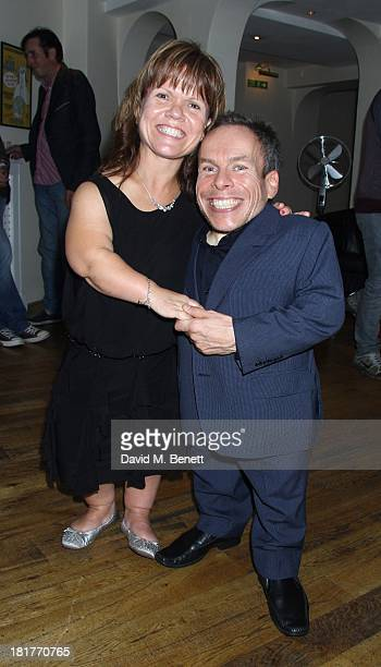 Actor Warrick Davis poses with wife Samantha Davis as he joins the West End Cast of Spamalot during the Spamalot Press Night at the Playhouse Theatre...