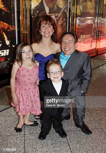 Actor Warwick Davis and family arrive at the UK Premiere of 'Johnny English Reborn' at Empire Leicester Square on October 2 2011 in London England