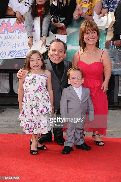 Actor Warwick Davis and family attend the World Premiere of Harry Potter and The Deathly Hallows Part 2 at Trafalgar Square on July 7 2011 in London...