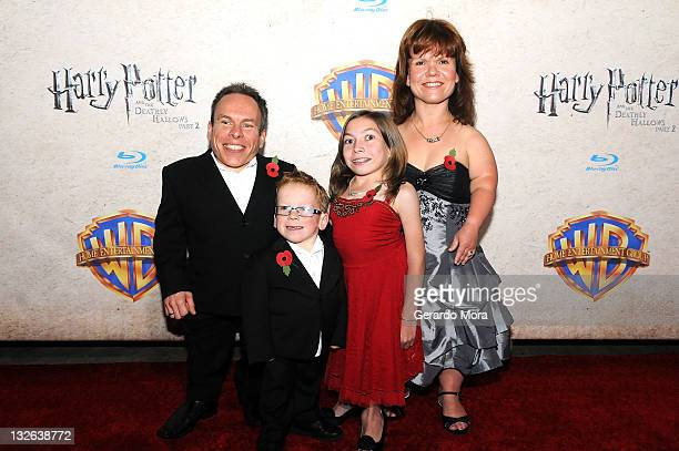 Actor Warwick Davis and his wife actress Samantha Davis and their children arrive at the Harry Potter and the Deathly Hallows Part 2 Celebration at...