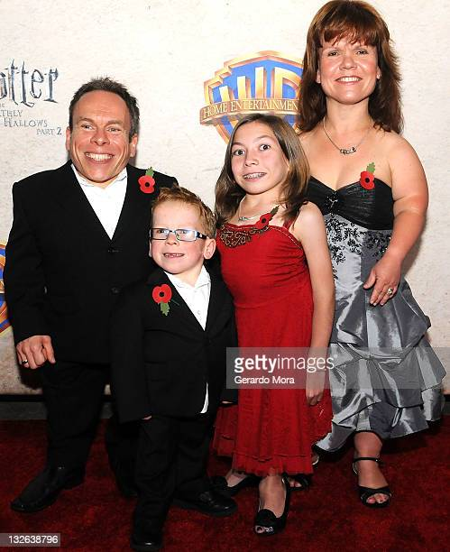 Actor Warwick Davis and his wife/actress Samantha Davis and their children arrive at the Harry Potter and the Deathly Hallows Part 2 Celebration at...