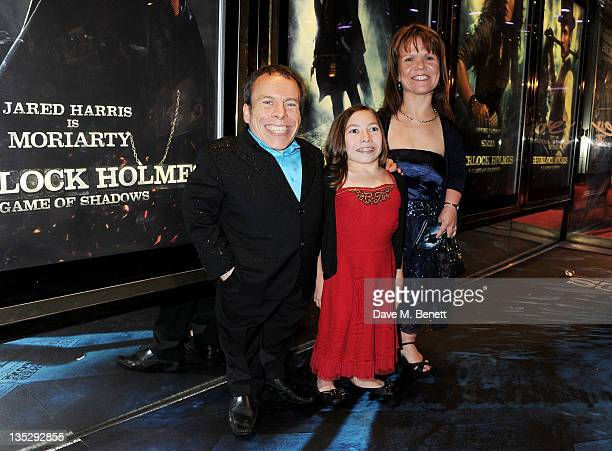 Actor Warwick Davis and wife Rosamund arrive at the European Premiere of 'Sherlock Holmes A Game of Shadows' at Empire Leicester Square on December 8...