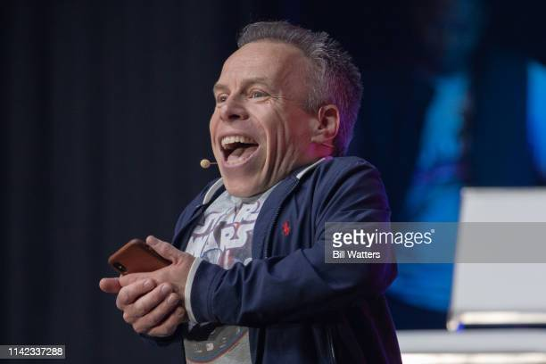 Actor Warwick Davis entertains the audience before the Star Wars Episode IX panel presentation at the 2019 Star Wars Celebration on April 12 2019 in...