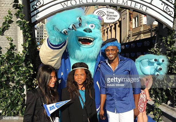 Actor Wayne Brady and daughter Maile Masako Brady and guest attend the world premiere of Disney Pixar's Monsters University at the El Capitan Theatre...