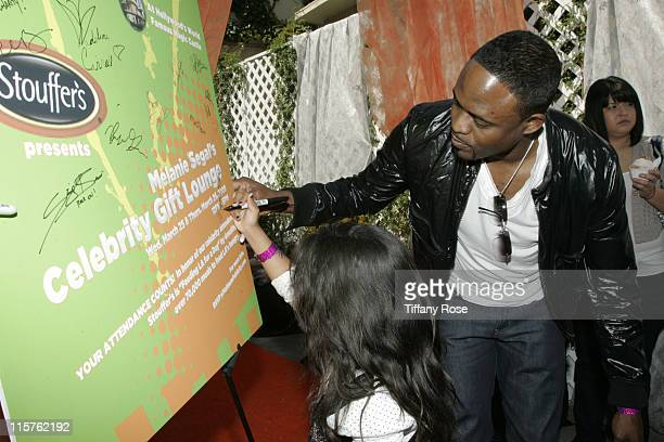 Actor Wayne Brady and his daughter Maile Brady autograph at day 1 of Melanie Segal's Kids' Choice Awards Lounge presented by Stouffer's at The Magic...