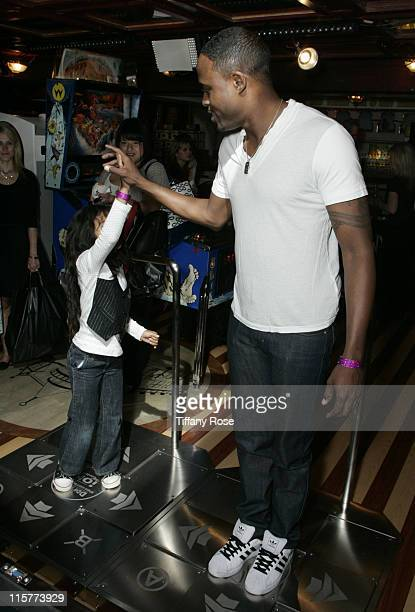 Actor Wayne Brady and his daughter Maile Brady highfive after playing Dance Dance Revolution at day 1 of Melanie Segal's Kids' Choice Awards Lounge...