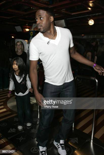 Actor Wayne Brady and his daughter Maile Brady play Dance Dance Revolution at day 1 of Melanie Segal's Kids' Choice Awards Lounge presented by...