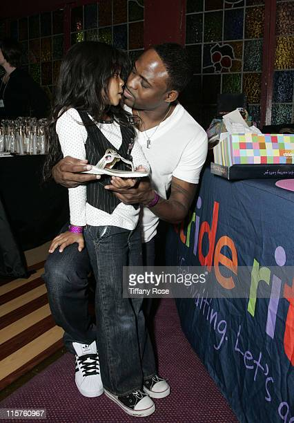 Actor Wayne Brady and his daughter Maile Brady receive a pair of Stride Rite sandals at day 1 of Melanie Segal's Kids' Choice Awards Lounge presented...
