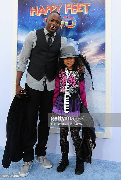 Actor Wayne Brady and his daughter pose on arrival for the world premiere of the movie 'Happy Feet Two' in Hollywood on November 13 2011 in southern...