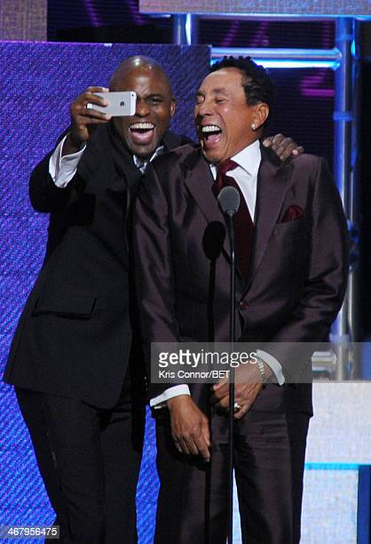 Actor Wayne Brady and musician Smokey Robinson pose onstage at BET Honors 2014 at Warner Theatre on February 8 2014 in Washington DC