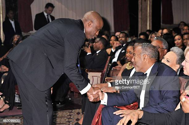 Actor Wayne Brady shakes hands with honoree John W Thompson during The BET Honors 2015 at Warner Theatre on January 24 2015 in Washington DC