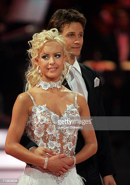"""Actor Wayne Carpendale and dancer Isabel Edvardsson smile at the dancing competition show """"Let's Dance"""" on TV station RTL with German celebrities and..."""