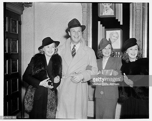 Actor Wayne Morris poses with actresses Lola Rosemary and Priscilla Lane in Los Angeles California