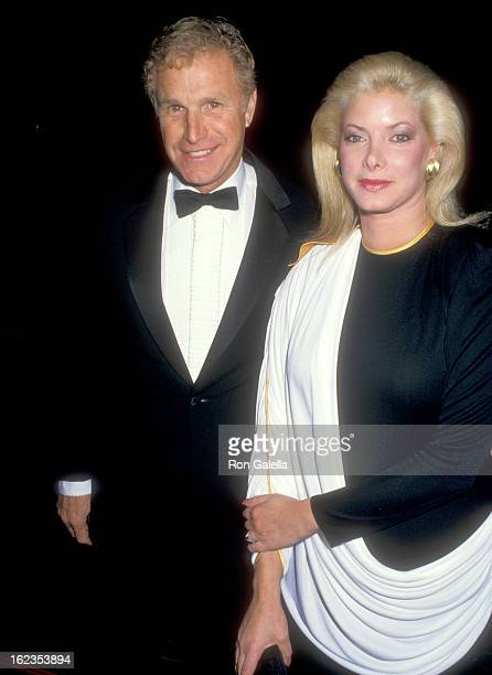 Actor Wayne Rogers and date Amy Hirsh attend the 'History of Hollywood' Costume Exhibition on December 3 1987 at Natural History Museum of Los...