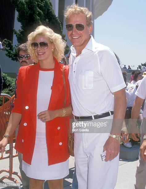 Actor Wayne Rogers and date Amy Hirsh attend the NBA Playoffs Game 7 Los Angeles Lakers vs Utah Jazz on May 22 1988 at The Forum in Los Angeles...