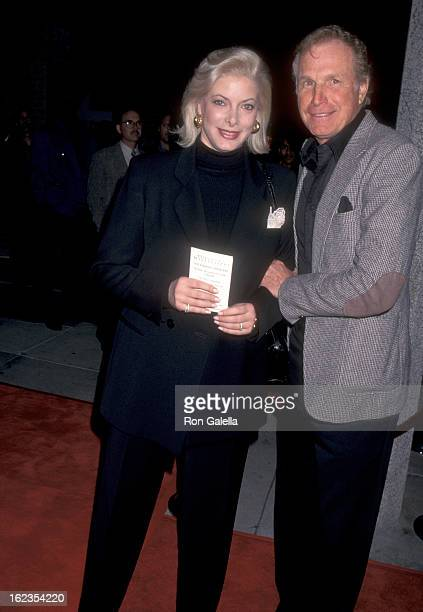 Actor Wayne Rogers and wife Amy Hirsh attend the 'Ghosts of Mississippi' Westwood Premiere on December 16 1996 at Mann National Theatre in Westwood...