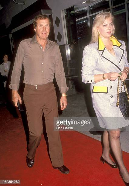 Actor Wayne Rogers and wife Amy Hirsh attend 'The Playboys' Santa Monica Premiere on April 28 1992 at Mann Criterion 6 Theatres in Santa Monica...