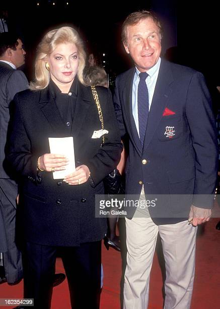 Actor Wayne Rogers and wife Amy Hirsh attend the 'Rush' Hollywood Premiere on December 18 1991 at Hollywood Galaxy Theatre in Hollywood California