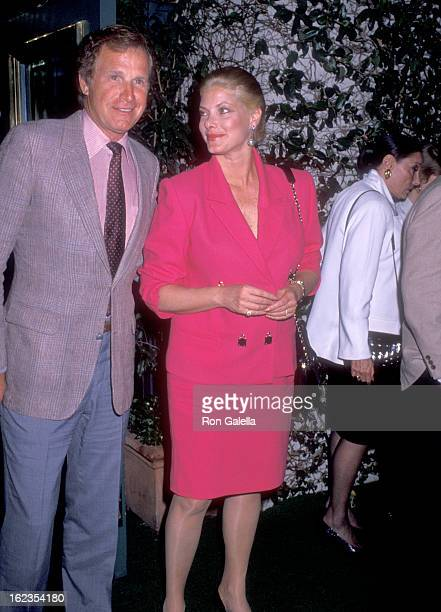 Actor Wayne Rogers and wife Amy Hirsh on March 17 1990 dine at Jimmy's Restaurant in Beverly Hills California