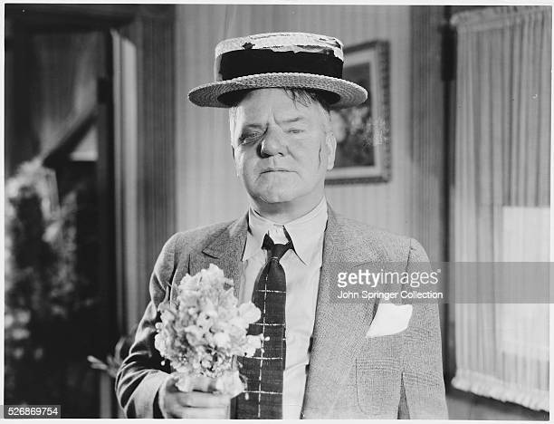 Actor WC Fields as Ambrose Wolfinger returns battered and bruised from a wrestling match in the 1935 comedy Man on the Flying Trapeze