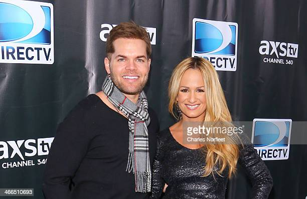Actor Wes Chatham and his wife television personality Jenn Brown attend the DirecTV Super Saturday Night at Pier 40 on February 1 2014 in New York...