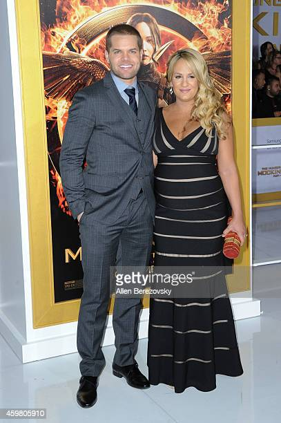 Actor Wes Chatham and Jenn Brown arrive at the Los Angeles premiere of The Hunger Games Mockingjay Part 1 at Nokia Theatre LA Live on November 17...