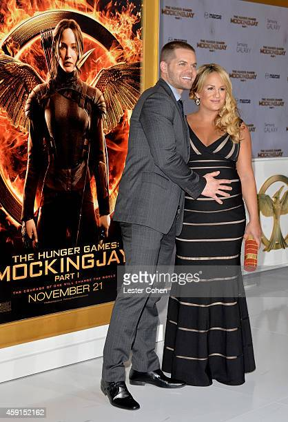 Actor Wes Chatham and Jenn Brown attend 'The Hunger Games Mockingjay Part 1' Los Angeles Premiere at Nokia Theatre LA Live on November 17 2014 in Los...