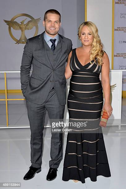 Actor Wes Chatham and Jenn Brown attend The Hunger Games Mockingjay Part 1 Los Angeles Premiere at Nokia Theatre LA Live on November 17 2014 in Los...