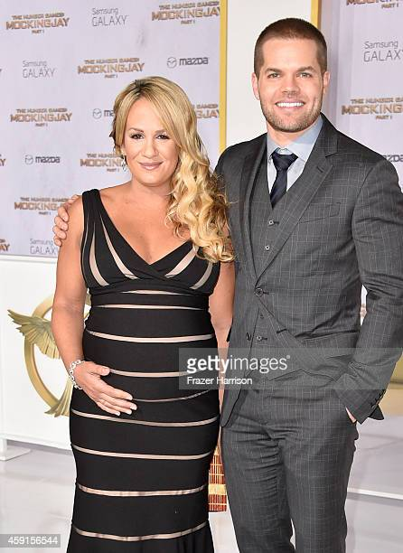 Actor Wes Chatham and Jenn Brown attend the premiere of Lionsgate's The Hunger Games Mockingjay Part 1 at Nokia Theatre LA Live on November 17 2014...