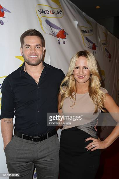 Actor Wes Chatham and sportscaster Jenn Brown arrive at the Stand Up for Gus benefit at Bootsy Bellows on November 13 2013 in West Hollywood...