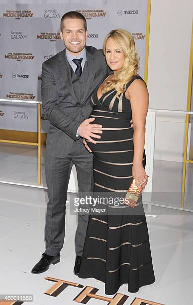 Actor Wes Chatham and TV personality Jenn Brown arrive at the 'The Hunger Games Mockingjay Part 1' Los Angeles Premiere at Nokia Theatre LA Live on...
