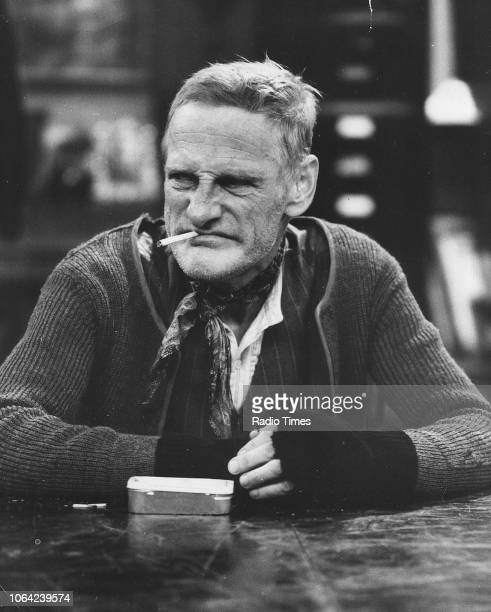 Actor Wilfrid Brambell smoking a cigarette in a scene from episode 'Homes Fit for Heroes' of the television sitcom 'Steptoe and Son' December 12th...