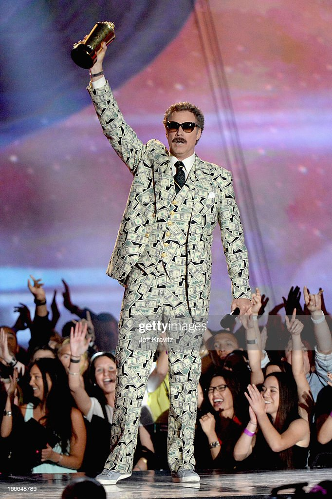 Actor Will Ferrell accepts award onstage during the 2013 MTV Movie Awards at Sony Pictures Studios on April 14, 2013 in Culver City, California.