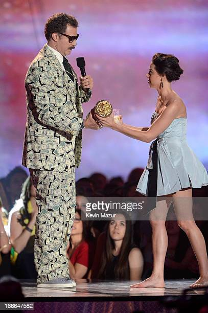 Actor Will Ferrell and actress Aubrey Plaza speak onstage during the 2013 MTV Movie Awards at Sony Pictures Studios on April 14, 2013 in Culver City,...