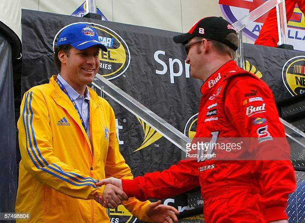 Actor Will Ferrell and Dale Earnhardt Jr., driver of the Budweiser Chevrolet before the start of the NASCAR Nextel Cup Series Aaron's 499 at the...