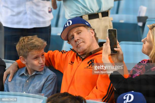 Actor Will Ferrell and his son pose for a picture for his wife Viveca Paulin before an MLB game between the Arizona Diamondbacks and the Los Angeles...