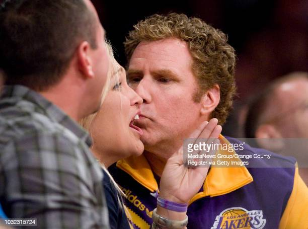 Actor Will Ferrell gets caught up by the kiss cam as he tries to smooch Kelly Davies of Manhattan Beach during the Lakers' 14294 loss to the Clippers...
