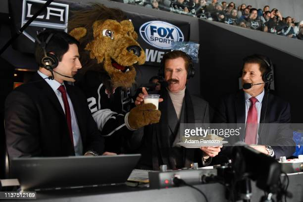 Actor Will Ferrell in character as Ron Burgundy is delivered a glass of milk and a burrito by Los Angeles Kings mascot Bailey as Ferrell calls the...