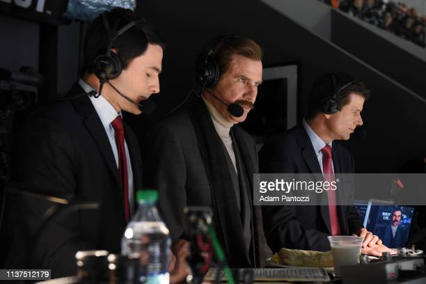Actor Will Ferrell in character as Ron Burgundy looks on while sitting with Fox Sports West broadcasters Jim Fox right and Alex Faust left as they...