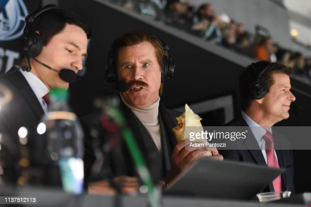 Actor Will Ferrell in character as Ron Burgundy talks with Fox Sports West broadcaster Alex Faust while eating a burrito as he calls the game from...