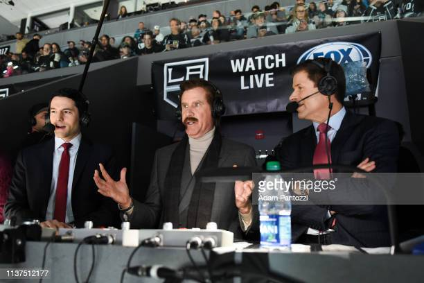 Actor Will Ferrell in character as Ron Burgundy talks with Fox Sports West broadcasters Jim Fox right and Alex Faust left as they call the game from...