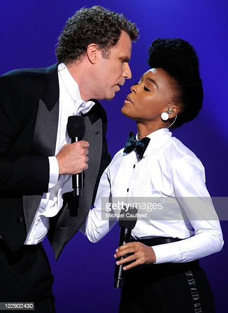 Actor Will Ferrell kisses singer Janelle Monae during the 2010 ESPY Awards at Nokia Theatre LA Live on July 14 2010 in Los Angeles California