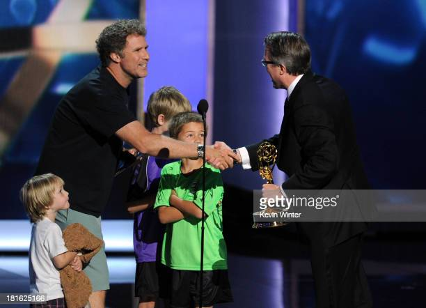 Actor Will Ferrell presents the award for Best Drama Series to Vince Gilligan onstage during the 65th Annual Primetime Emmy Awards held at Nokia...