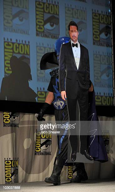 """Actor Will Ferrell walks onstage carrying a cardboard cut-out of Brad Pitt at the """"Megamind"""" panel during Comic-Con 2010 at San Diego Convention..."""