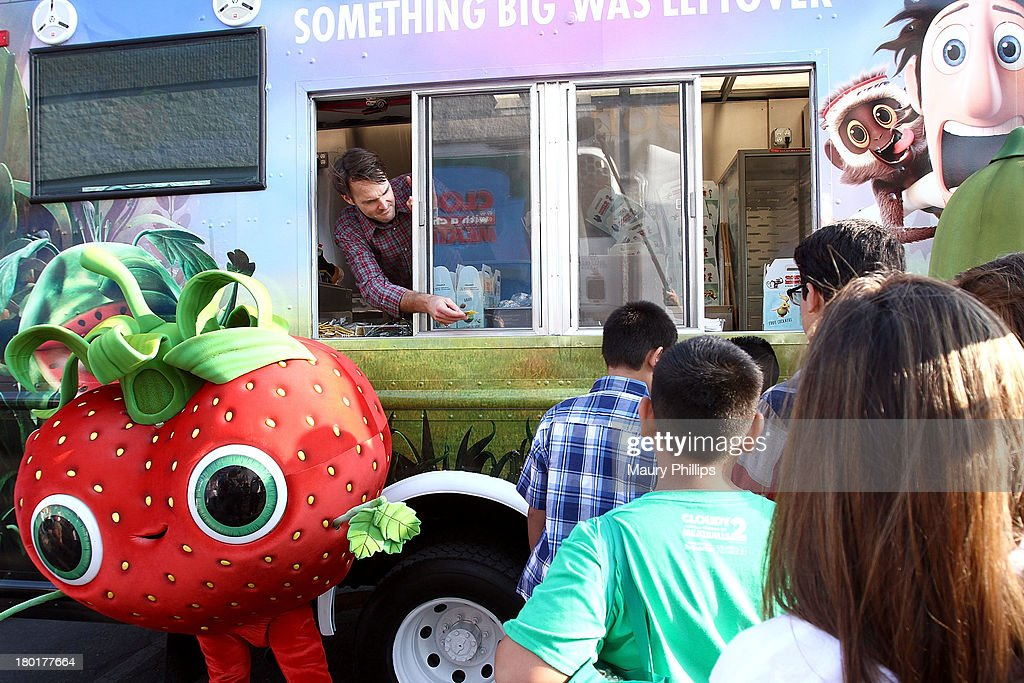 Actor Will Forte (L) at the Los Angeles Regional Food Bank with Feeding America for Sony Pictures Animation's 'Cloudy with a Chance of Meatballs 2' on September 9, 2013 in Los Angeles, California.